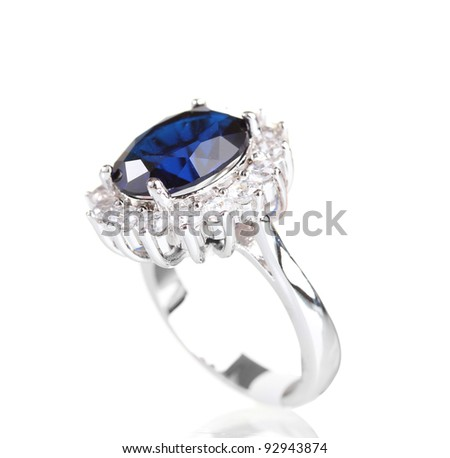 beautiful ring with blue gem isolated on white - stock photo