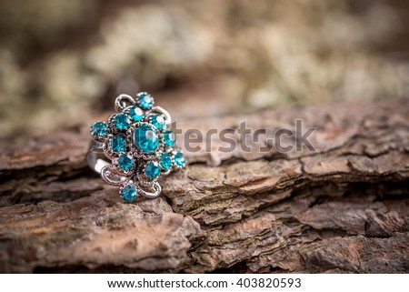 Beautiful ring with small blue glass stones - stock photo