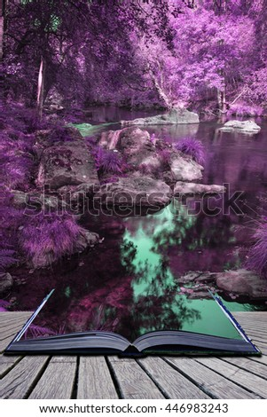 Beautiful river flowing through surreal alternate colored forest landscape - stock photo