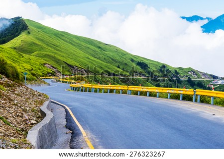 Beautiful road on mountain top in  Taiwan - stock photo