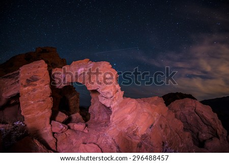 Beautiful rock formations against bright starry sky at night. Valley of Fire Overton Nevada USA - stock photo