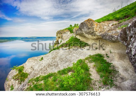 Beautiful rock on the coast of the river on a sunny day - stock photo