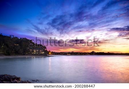 Beautiful rocky landscape sunset overlooking the ocean (Long Exposure), Noosa Heads, Sunshine Coast, Australia - stock photo