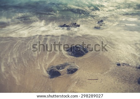 Beautiful rocky sea shore at sunrise or sunset. Long exposure landscape. Crete. - stock photo