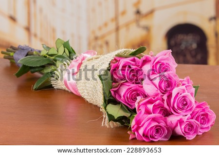 beautiful romantic bouquet of Ecuadorian pink roses on a table - stock photo