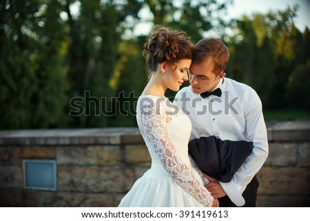 Beautiful romantic couple in old town - stock photo