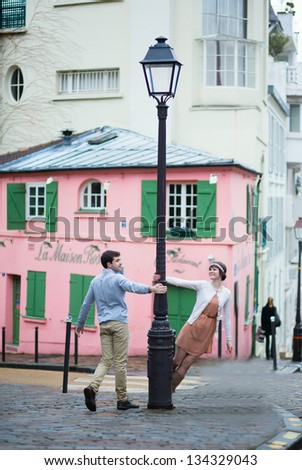 Beautiful romantic couple on Montmartre in Paris - stock photo