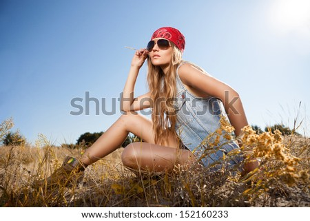 Beautiful romantic girl outdoors. Attractive young girl in a summer field. - stock photo