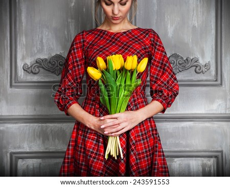Beautiful romantic woman with blond hair with tulip bouquet - stock photo