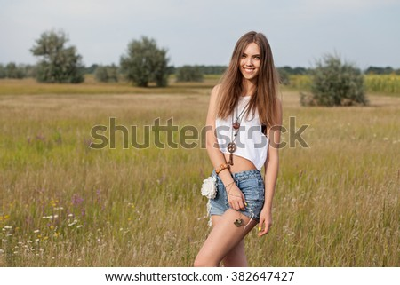 Beautiful Romantic Young  Woman Outdoors. Enjoy Nature. Healthy Smiling Girl in Green Grass. Portrait of a smiling Teenage Model in sunny day - stock photo