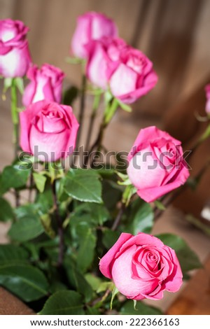 Beautiful rose bouquet on vase on the table - stock photo