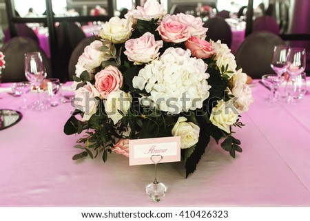 Beautiful rose bouquet with fresh white and pink flowers at wedding reception - stock photo