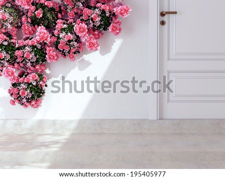 Beautiful roses in front of white wall. Entrance of a house. - stock photo