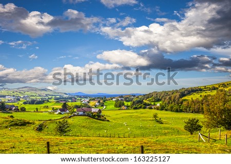 Beautiful rural landscape with small village on a lake coast in Norway. - stock photo