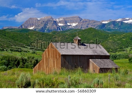 Beautiful rustic barn in Rocky Mountains - stock photo