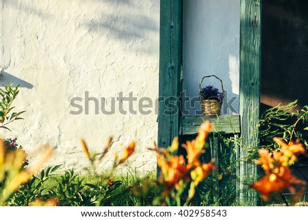 beautiful rustic wooden porch old building in sunny garden, exploring country, travel concept - stock photo