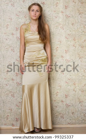 Beautiful sad girl in the dress photography studio - stock photo