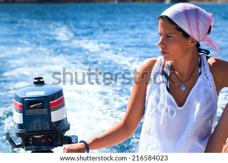 Beautiful Sailor/Driving a boat - stock photo