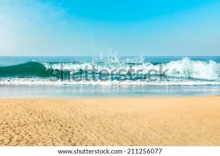 Beautiful sand beach at tropical sea - stock photo
