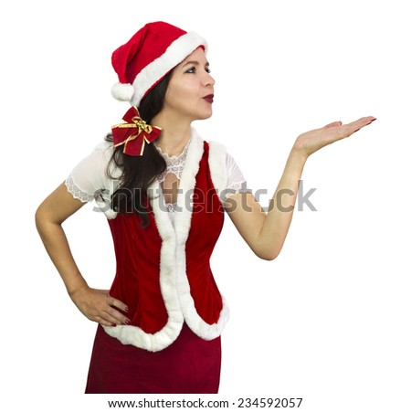 Beautiful Santa girl in red fur costume blowing a kiss, Christmas and New Year image, isolated on white - stock photo