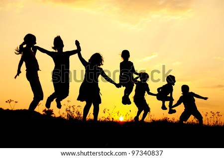 Beautiful scene of children jumping in nature - stock photo
