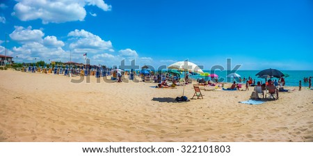 Beautiful scene of typical vacation beach with beach chairs and sun shades on a sunny day at Lido di Metaponto, Basilicata, Italy - stock photo