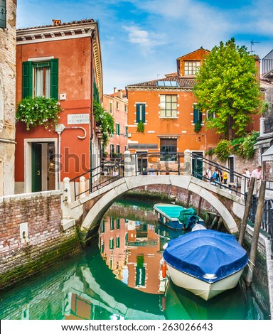 Beautiful scene with old colorful houses and boats on a small channel in Venice, Italy - stock photo