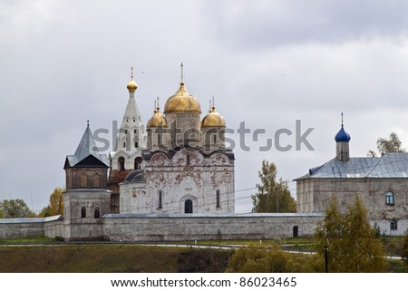 Beautiful scenery. Golden domes of the church against the background of the cloudy autumn sky. - stock photo