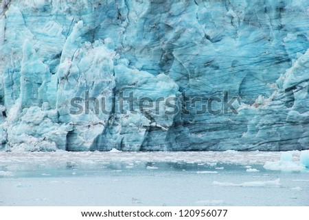 Beautiful scenery image - melting blue ice of Esmark's glacier in Istfjorden bay - view from cruise ship, Spitsbergen archipelago (Svalbard island), Norway, Greenland Sea - stock photo
