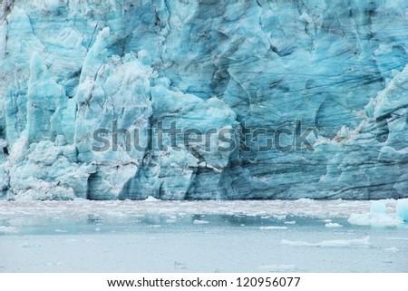 Beautiful scenery image of Esmark's glacier blue ice in Istfjorden - view from cruise ship, Spitsbergen archipelago (Svalbard island), Norway, Greenland Sea - stock photo