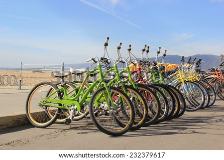 Beautiful scenery of Santa Monica Beach with bicycles ready for tourists - stock photo