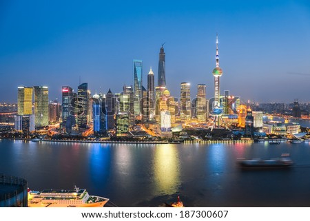 beautiful scenery of the modern city at night in shanghai   - stock photo