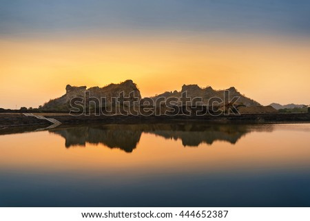 Beautiful scenery sunset sky view of lake and mountain reflection in water. - stock photo