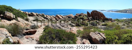 Beautiful scenic panorama of the  remote ancient  uninhabited rocky coastline at Cape Clairault Western Australia on a fine sunny day in late autumn. - stock photo