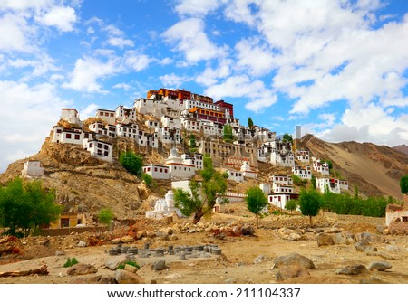 Beautiful scenic view - ancient Thiksey Buddhist Monastery and traditional Tibetan houses against the background of bright blue sky - Leh district, Ladakh, Himalaya, Jammu & Kashmir, Northern India - stock photo