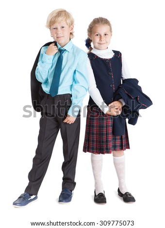 Beautiful schoolchildren with jackets in hands standing together full length, isolated over white background - stock photo