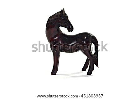 Beautiful sculpture of horse made of wood isolated on the white background - stock photo