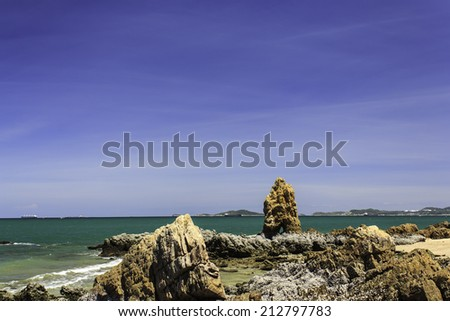 Beautiful sea and rocks daytime. - stock photo