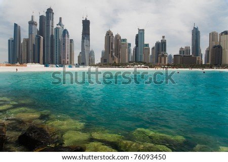 Beautiful sea bay on the background of the modern city. - stock photo