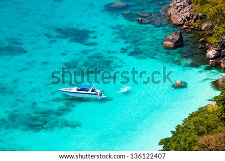 Beautiful sea landscape with tropical coast and the high-speed boat, standing near the shore - stock photo