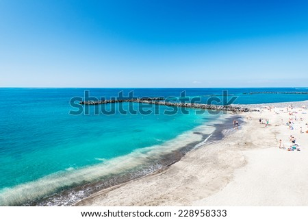 Beautiful sea water of tropical El Duque beach, Tenerife, Canary islands, Spain - stock photo