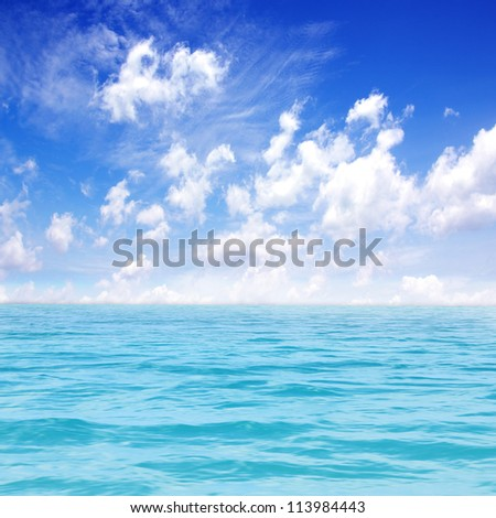Beautiful sea with blue sky background - stock photo