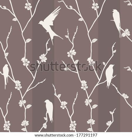 Beautiful seamless pattern with bird on sakura branches. - stock photo