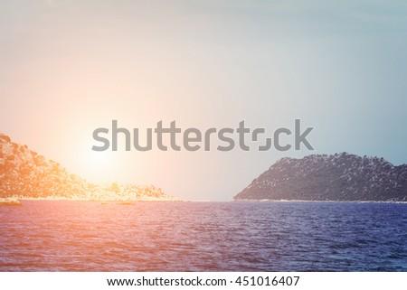Beautiful seascape: Beautiful seascape: water and rock. Toned - stock photo