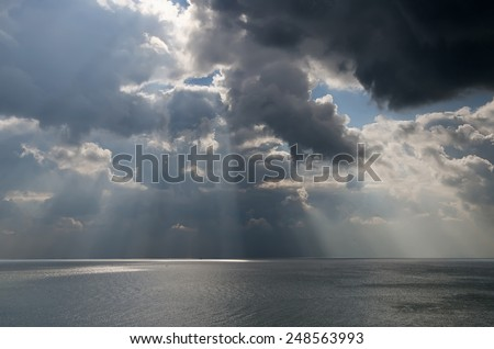 Beautiful seascape - dramatic clouds over the sea - stock photo