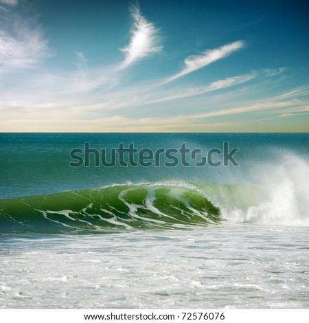 Beautiful seascape with a single perfect wave - stock photo