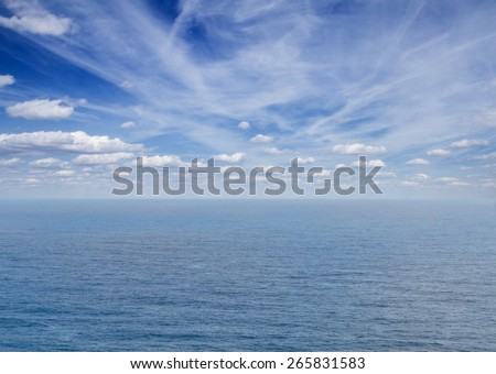 beautiful seascape with deep  blue ocean  waters and clouds  - stock photo