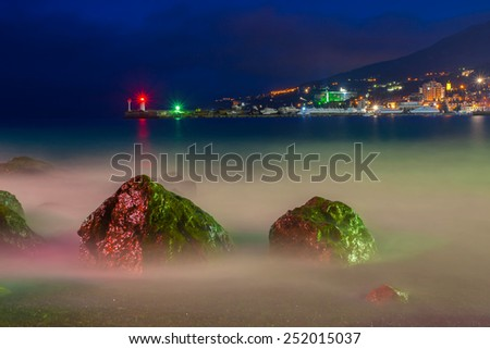 Beautiful seascape with lighthouse - stock photo