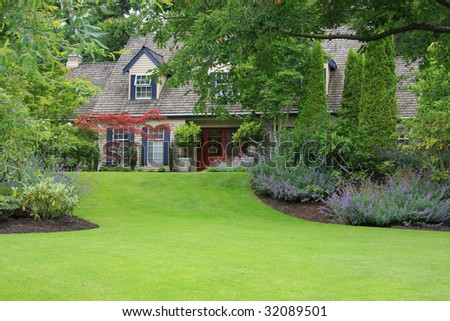 Beautiful secluded house with large front lawn. - stock photo