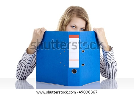 Beautiful secretary keep out of taxes (fear of tax concept) - stock photo